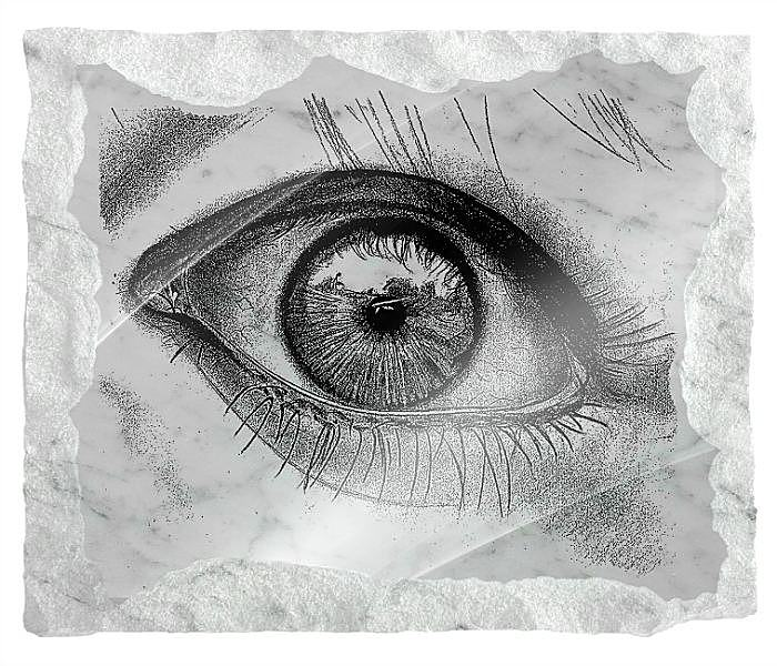 Eye etched on a white marble background