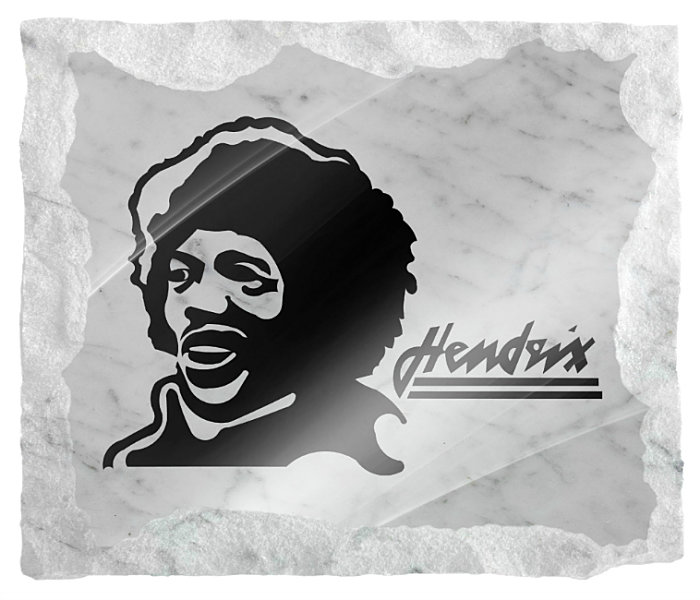 Memorial Image of Jimmy Hendrix etched on a white marble background