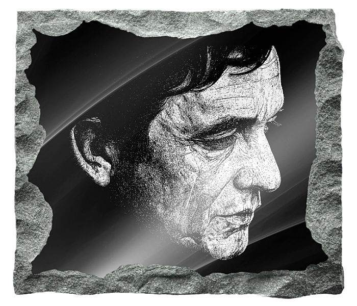 Memorial image of Johnny Cash etched on a black granite background