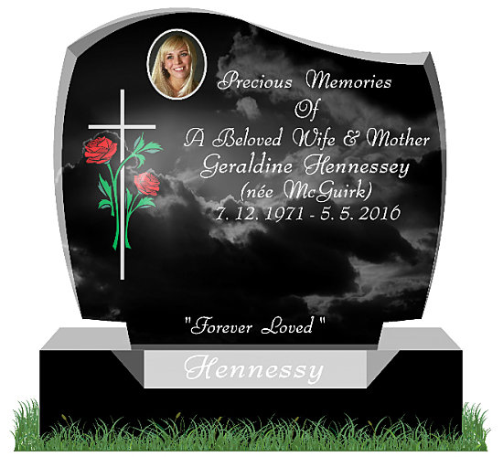 D30 Gravestone in Black Granite. Two red roses are etched along side a slim cross on the left. An oval ceramic photo is positioned on the top. Inscriptions engraved in silver. Surname engraved on a sunken base. Font: Bernhard Modern BT with Swash Lettering