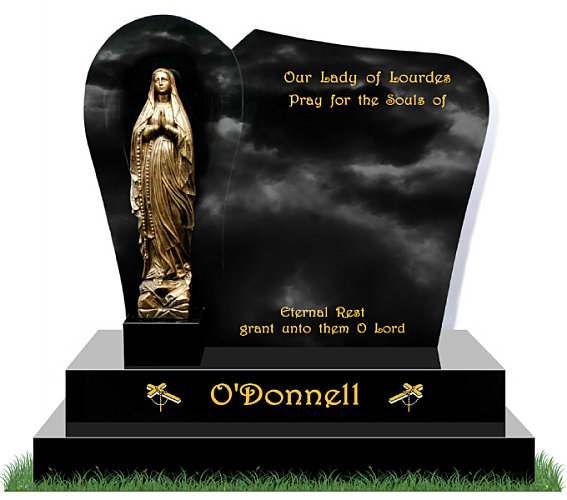 Small Grotto Gravestone in Black Granite. Bronze Statue of Our Lady of Lourdes is positioned in front of a recessed grotto. Images of cross and beads etched in gold and silver each side of the surname. Inscriptions engraved in gold leaf. Font: Harrington Script lettering.