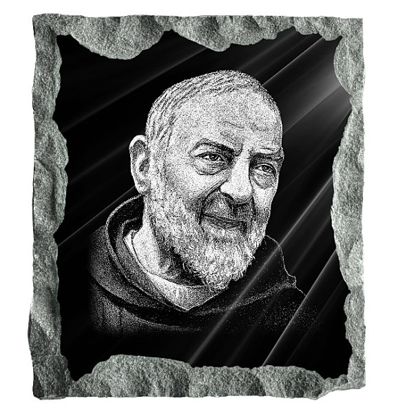 Memorial image of Saint Padre Pio etched on black granite.