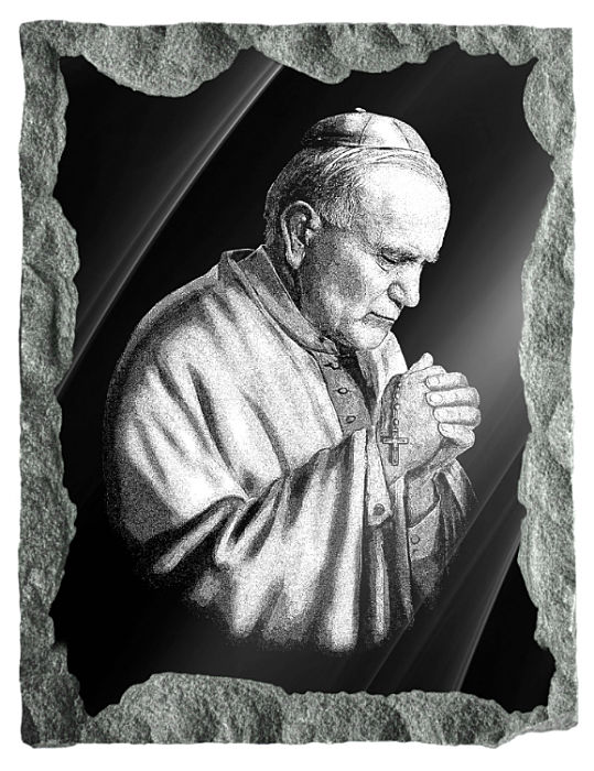 Image of Saint John Paul II etched on black granite.