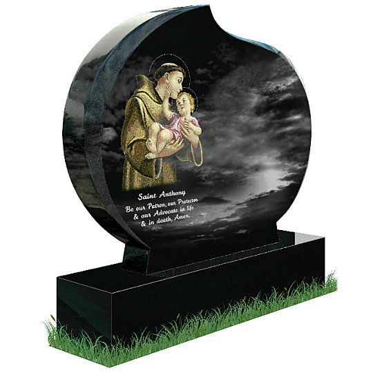 Modern Oval Memorial in Black Granite (angle view). Saint Anthony holding the Child Jesus Is etched in color on the left with a short prayer to the famous saint below. Inscriptions engraved in Gold and Silver. Font: Tartine Script lettering.