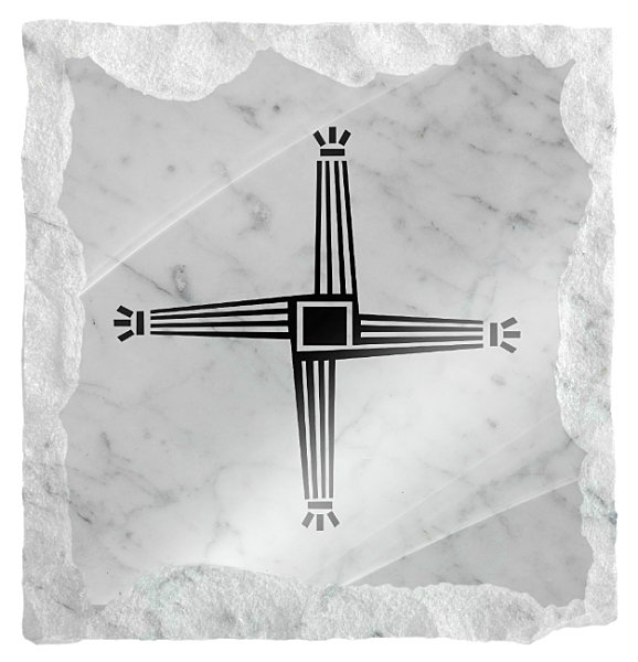 Image of Saint Brigids cross etched on a white marble background