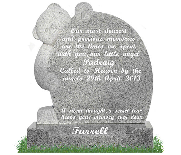 Small Teddy Bear Headstone in Grey Granite. Carved Teddy Bear on left with inscriptions engraved in silver on the right. Surname engraved on a sunken base. Font: Script Bold lettering.