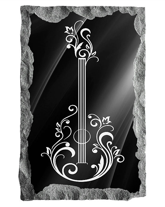 Image of decorative guitar etched in silver on a black granite background