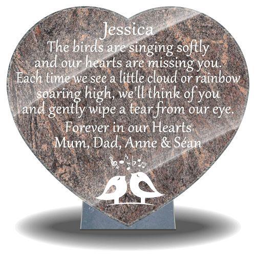 Musician's Memorial with bird singing memories on granite grave plaques