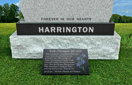 Forget me not flowers for Mum's grave on granite plaque
