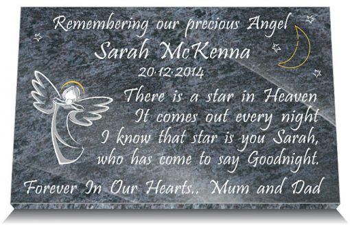 Little headstone tribute with angel and moon and stars