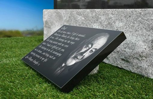 Grave plaques with memorial verses for father from daughter