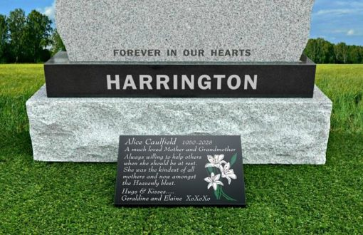 White Lilies engraved on memorial plaque with funeral poem