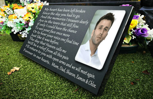Outdoor memorial plaques with photo and memorial verses for a brother or son